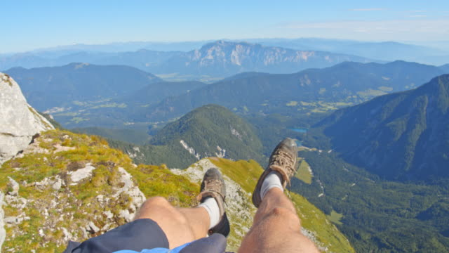 pov unrecognizable hiker enjoying the view of the julian alps - human leg stock videos & royalty-free footage
