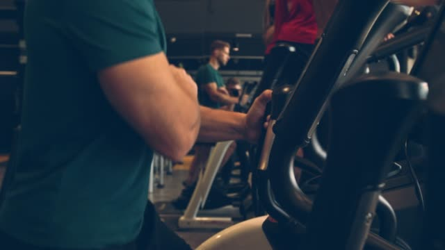 unrecognizable male athlete working out on elliptical machine - cross trainer stock videos & royalty-free footage