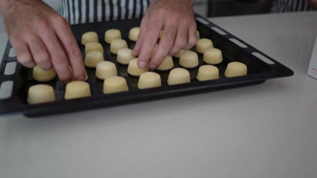 unrecognizable man arranging cookies on baking tray - baking tray stock videos & royalty-free footage