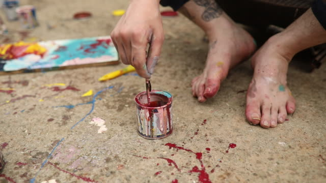 unrecognizable man painting in his backyard - painting toenails stock videos & royalty-free footage