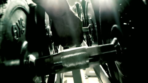 slo mo unrecognizable man picking up dumbbells - weight training stock videos & royalty-free footage