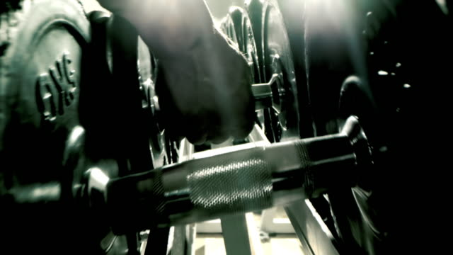 slo mo unrecognizable man picking up dumbbells - dumbbell stock videos & royalty-free footage