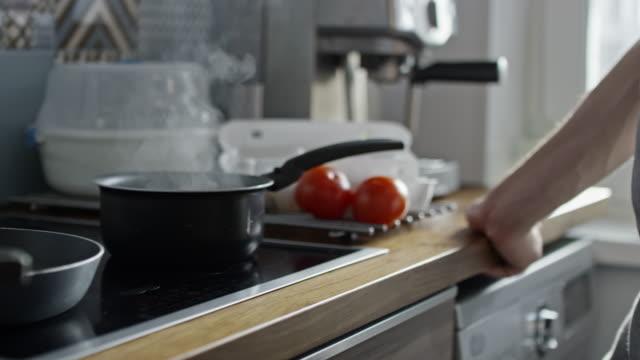 unrecognizable man preparing breakfast in morning - preparing food stock videos & royalty-free footage