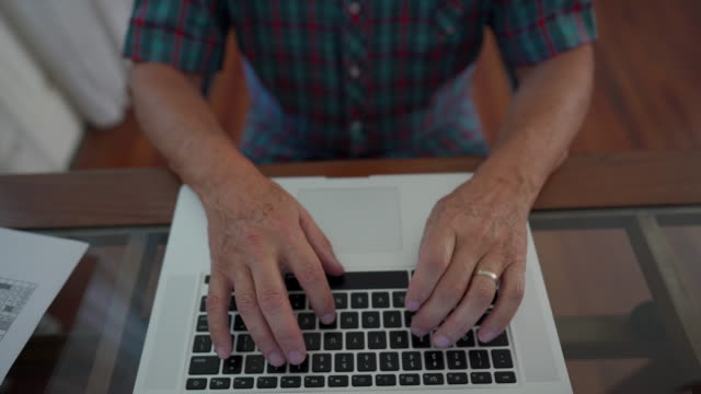unrecognizable man  typing an email on laptop - mature men stock videos & royalty-free footage