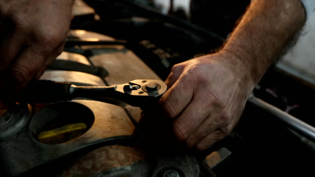 unrecognizable mature mechanic working - wrench stock videos & royalty-free footage