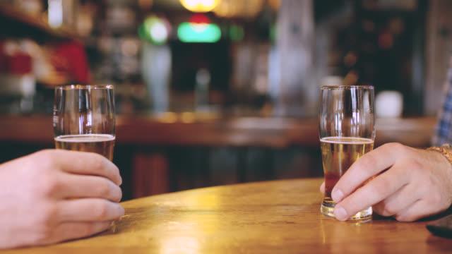 DS CU Unrecognizable men having a drink in the pub