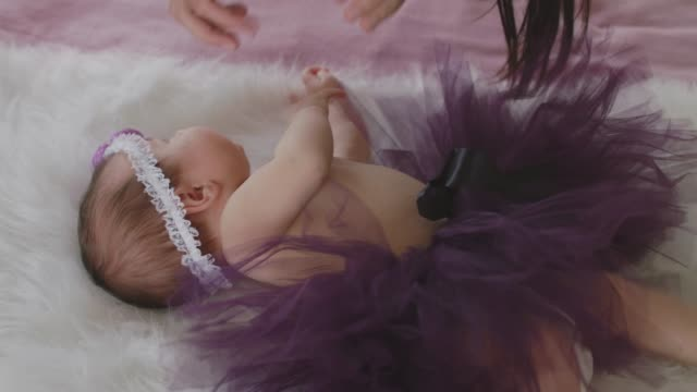 unrecognizable mother playing with her newborn baby girl - tutu stock videos & royalty-free footage