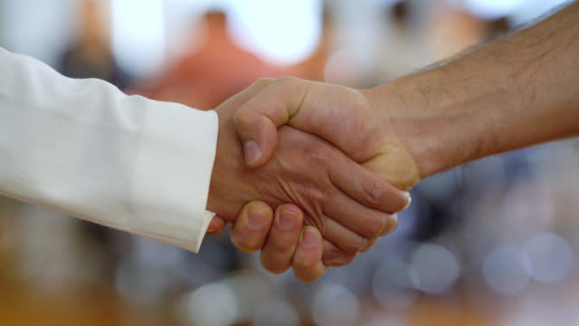 unrecognizable people at the office closing a deal handshaking - selling stock videos & royalty-free footage