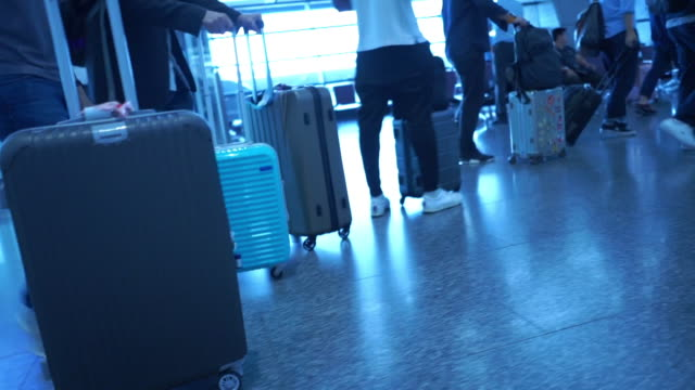 unrecognizable people drag luggage at the airport - crew stock videos & royalty-free footage