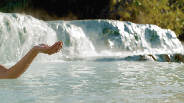super slo mo unrecognizable person at the saturnia hot springs - hot tub stock videos & royalty-free footage