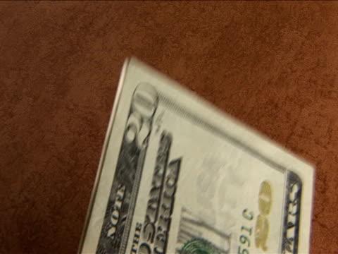 ecu, unrecognizable person counting money - banconota da 10 dollari statunitensi video stock e b–roll