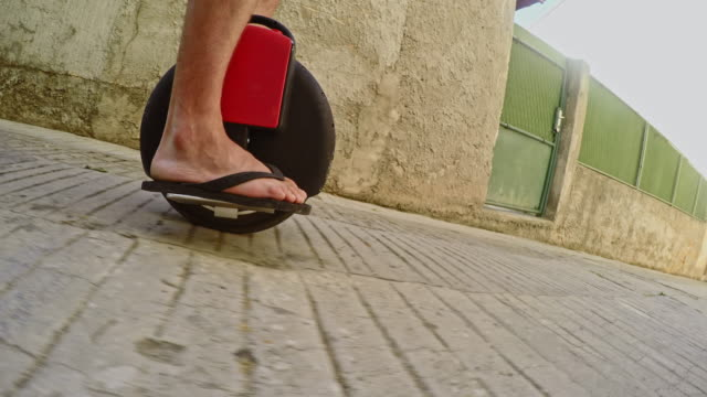 unrecognizable person riding a self-balancing board - flip flop stock videos and b-roll footage