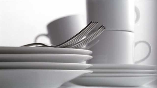 ECU TU unrecognizable person taking forks from pile of plates