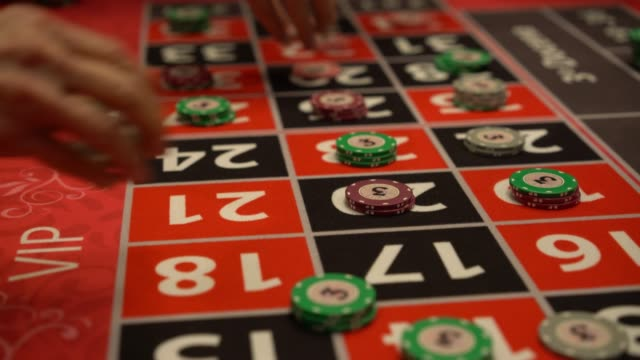 unrecognizable players placing bets on roulette table - putting stock videos & royalty-free footage