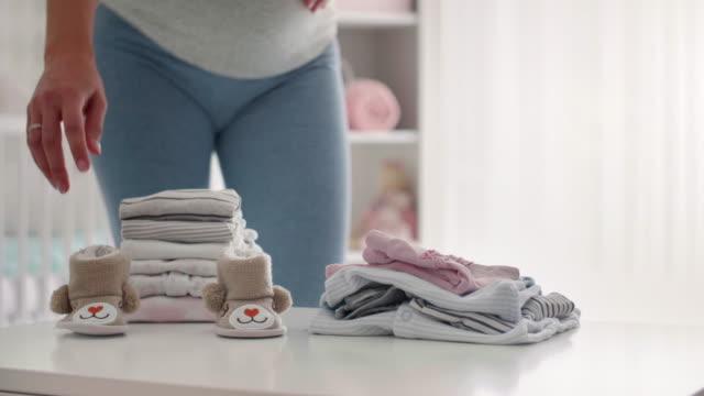 unrecognizable pregnant woman at nursery bedroom/ debica/ poland - nursery bedroom stock videos & royalty-free footage