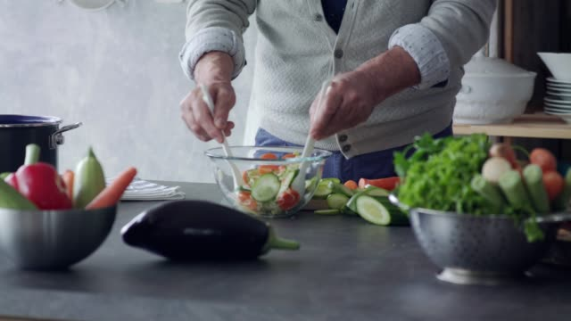 unrecognizable senior man preparing a salad - healthy eating stock videos & royalty-free footage