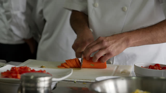 unrecognizable sous chef chopping a carrot for a salad - unrecognizable person stock videos & royalty-free footage