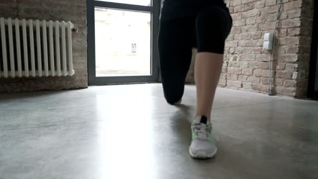 unrecognizable woman doing jump lunges - lunge stock videos & royalty-free footage