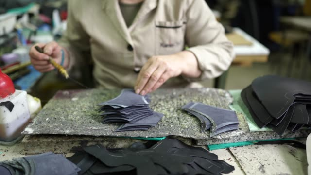 unrecognizable woman making shoes - leather stock videos & royalty-free footage
