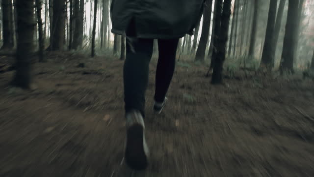 pov unrecognizable woman running for her life - spooky stock videos & royalty-free footage