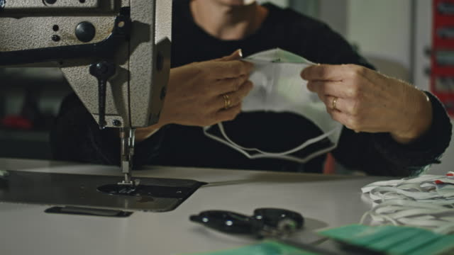 slo mo unrecognizable woman sewing homemade masks - sewing stock videos & royalty-free footage