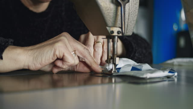 slo mo unrecognizable woman sewing medical masks at home - home made stock videos & royalty-free footage