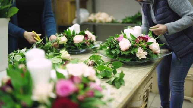 unrecognizable women making wedding decoration - flower arrangement stock videos & royalty-free footage