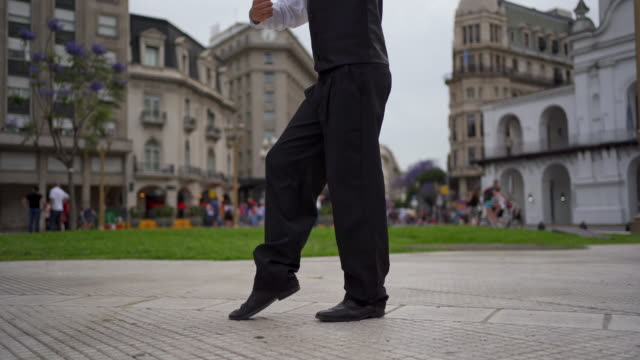 unrecognizable young man dancing tango alone on a town square - tangoing stock videos & royalty-free footage