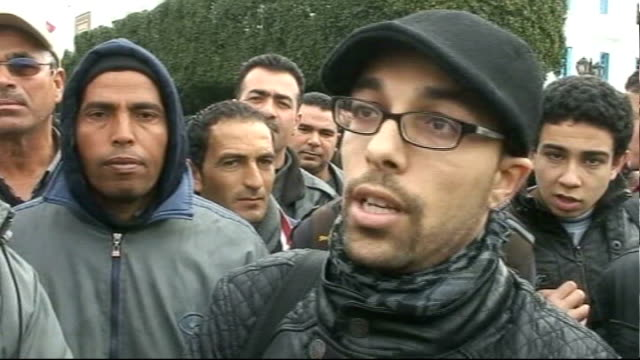 Unrest across the region TUNISIA Tunis EXT Antigovernment protesters chanting SOT Protesters applauding and chanting Vox pops Protesters holding...