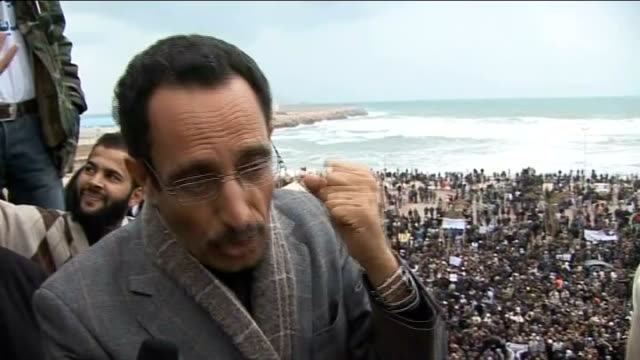 Gaddafi vows to continue fight against opposition LIBYA Benghazi EXT Coffin of man killed during protests against Libyan Leader Colonel Muammar...