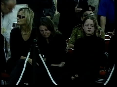 israeli retaliation for murder of cabinet minister; pool via reuters jerusalem: ext tms people gathered around coffin of assassinated cabinet... - イスラエル点の映像素材/bロール
