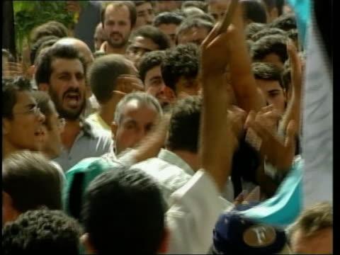 stockvideo's en b-roll-footage met unrest/paris talks unrest/paris talks nablus funeral procession along street body of palestinian killed in unrest carried along body of victim... - israëlisch palestijns conflict