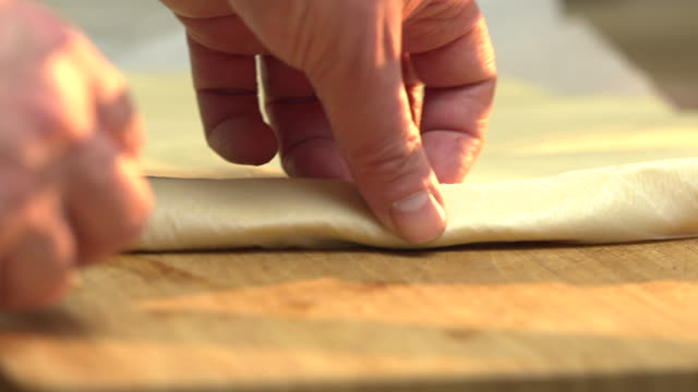 unrolling puff pastry sheet - puff pastry stock videos & royalty-free footage