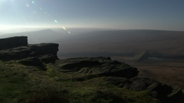 unseasonably dry weather partly to blame for february wildfires; uk, west yorkshire; firefighters on saddleworth moor tackling wildfires, burnt... - west yorkshire stock videos & royalty-free footage