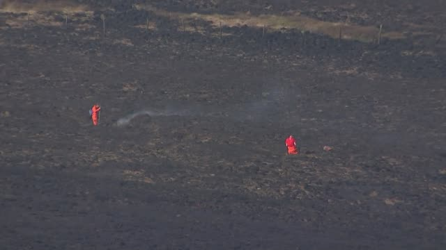 unseasonably dry weather partly to blame for february wildfires; england: west yorkshire: marsden: ext national trust rangers on saddleworth moor... - national trust video stock e b–roll