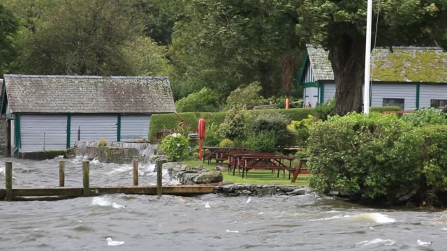 unseasonal storm force winds blowing over lake windermere in ambleside lake district uk in the summer - lakeshore stock videos & royalty-free footage