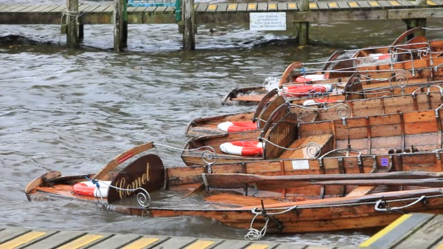 unseasonal storm force winds swamping rowing boats on lake windermere in ambleside, lake district uk in the summer. - oar stock videos & royalty-free footage