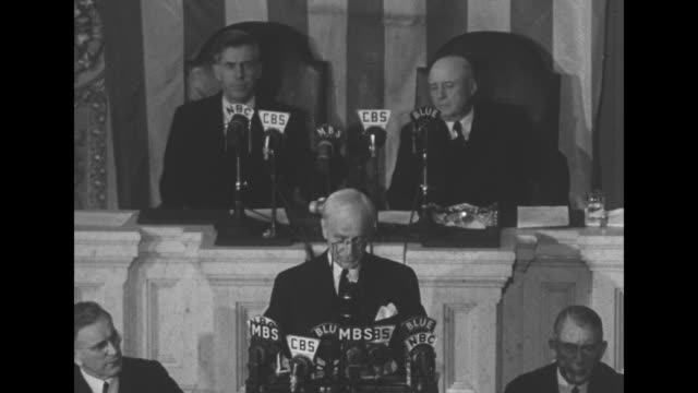 vo unseen audience applauds as standing on rostrum us secretary of state cordell hull reports to congress on the third moscow conference from which... - cordell hull stock videos and b-roll footage