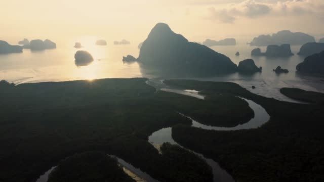 unseen thailand : 4k footage aerial view hyper lapse  of phang nga bay in sunrise, thailand - standing water stock videos & royalty-free footage