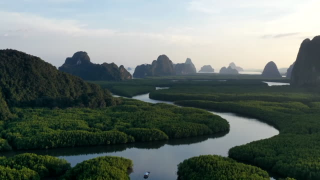 unseen thailand : hyperlapse aerial view of phang nga bay in sunset, thailand - gold coloured stock videos & royalty-free footage