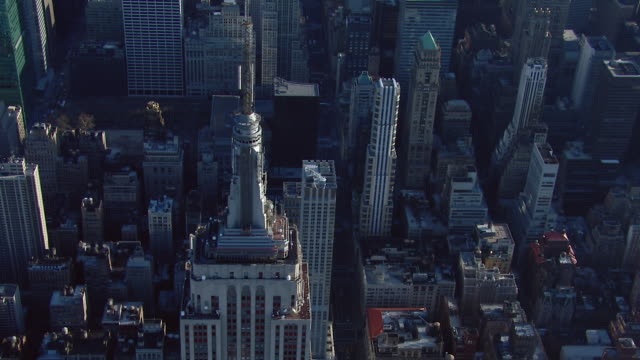 Unsettling parallax view of the top of the Empire State Building in New York City, New York, USA.