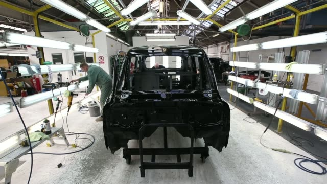 unsprayed tx4 euro 5 london taxi cab shells sit on the production line in the paint shop at the london taxi company's assembly plant a unit of... - coventry stock videos & royalty-free footage