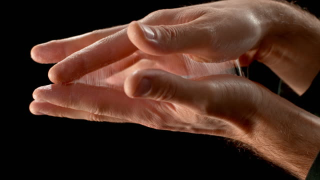 slo mo ld unsticking glued hands - trapped stock videos & royalty-free footage