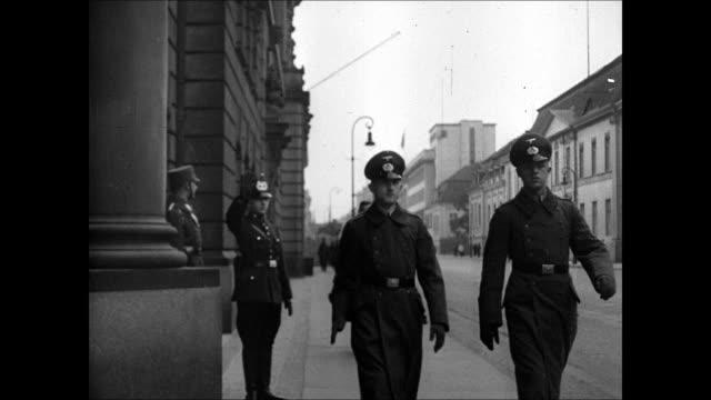 unter den linden boulevard street sign. gestapo police officers walking down sidewalk, saluting. propaganda minister joseph goebbels reading speech... - ゲシュタポ点の映像素材/bロール
