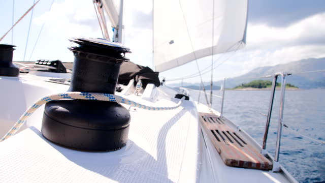 slo mo untightening the sail - pulley stock videos & royalty-free footage