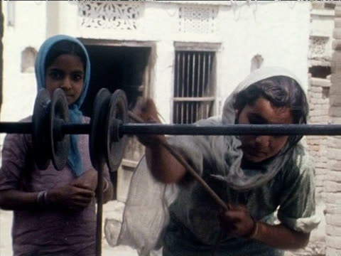 untouchable mother and daughter haul bucket up well on pulley india mar 77 - dalit stock videos and b-roll footage