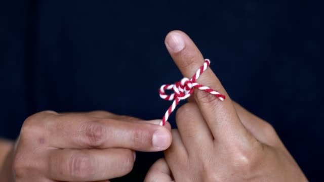 untying reminder ribbon from finger - index finger stock videos & royalty-free footage