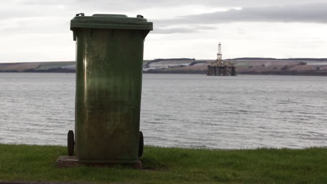 unused oil rigs stand in the port of cromarty firth in cromarty uk on tuesday feb 16 the west phoenix oil platform operated by seadrill norge as... - u bahnsteig stock-videos und b-roll-filmmaterial