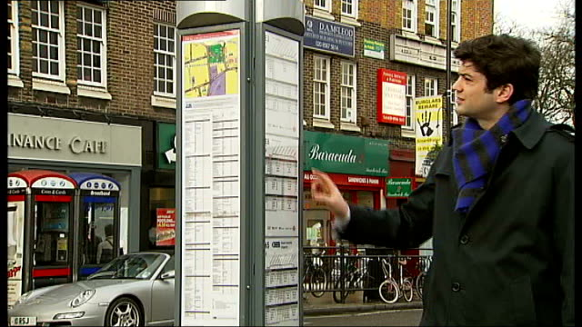 unused rail replacement bus service from west london to brighton; england: west london: ealing broadway: ext itn reporter looking at bus stop... - 代理点の映像素材/bロール