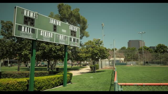 unused scoreboard at empty baseball diamond, no people, during april 2020 covid-19 - scoring stock videos & royalty-free footage